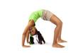 Young baby artistic gymnast doing bridge, isolated