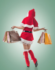 Christmas girl holding shopping bags