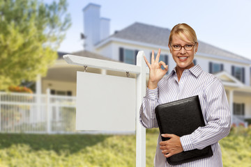 Real Estate Agent in Front of Blank Sign and House