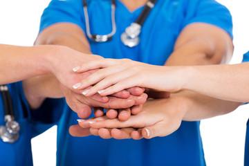 group of medical doctors hands together