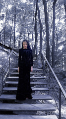 female model  in black dress on the stairs