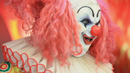 Scary clown doll face  smiling.
