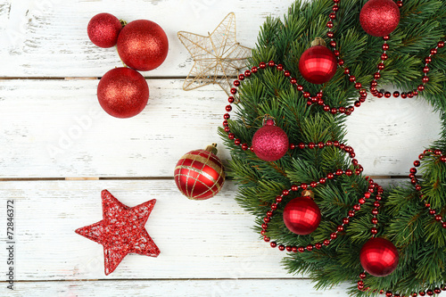 canvas print picture Green Christmas wreath with decorations on wooden background