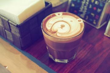 coffee latte on wooden desk in coffee shop