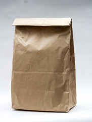 Realistic brown paper bag on white background