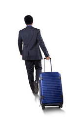 Businessperson carrying luggage to travel