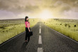Businesswoman standing on the highway road 4