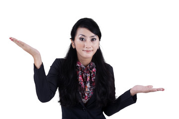 Businesswoman with confused gesture