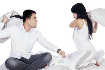Couple having conflict on bed