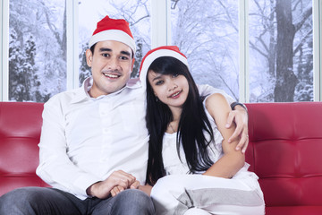 Couple in christmas hat holding hands