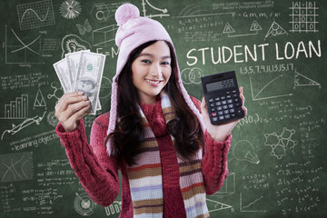 Student hold money and calculator