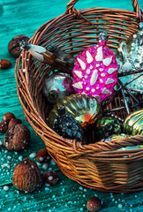 wicker basket with an old-fashioned glass toys
