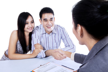 Young couple hand shake with businesswoman