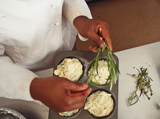 Overhead of pastry chef making rosemary herb savoury muffins