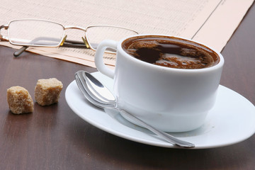 Having a cup of coffee