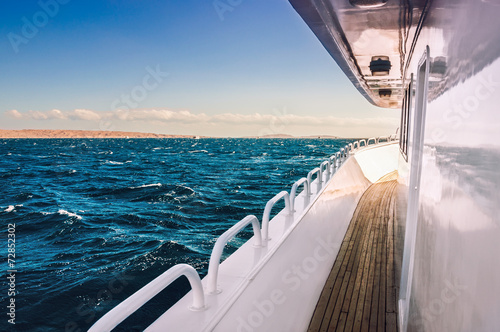 Deurstickers Egypte White yacht in the red sea at sunset
