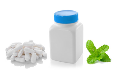 Medicine bottle pill and mint  isolated on white background