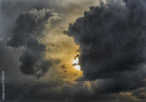 Dramatic cloudy sunset - 72852941