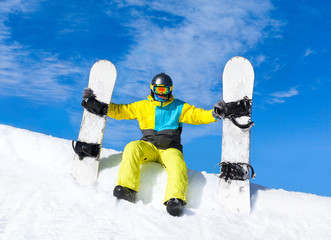Snowboarder sitting snow slope snowboards
