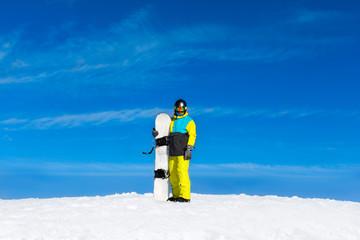 snowboarder standing hold snowboard