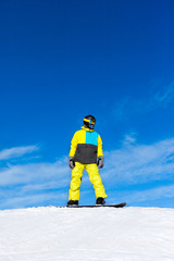 Snowboarder sliding down the hill, snow mountains