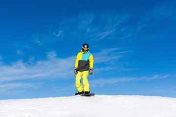Snowboarder sliding down the hill