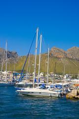 Yacht in harbor and mountains of Port de Pollenca, Mallorca