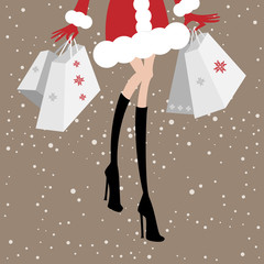 Christmas sale. Shopping fashionable woman with shopping bags.