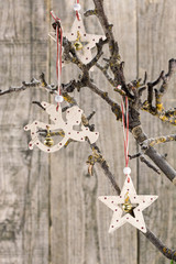 Christmas star and angel hanging over old wooden board