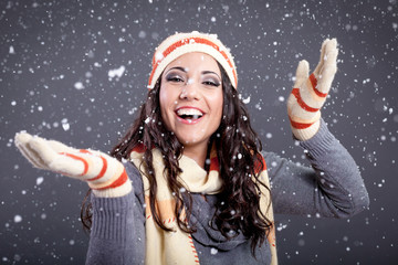 Beauty portrait of young attractive woman over snowy Christmas b