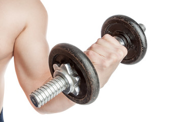 Young healthy guy with a dumbbell. Doing biceps.