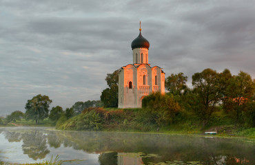 Morning fog over a pond near  temple of Intercession on Nerli