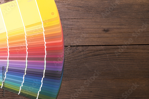 Poster Color Catalogue on wooden desk