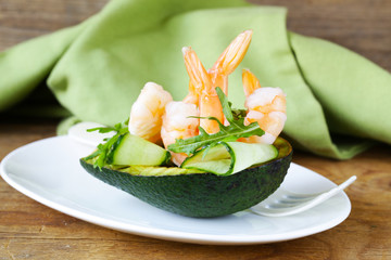 Fresh avocado with shrimp and cucumber served on a plate