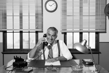 1950s smiling businessman on the phone