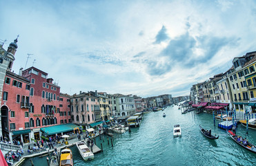 VENICE - APRIL 7, 2014: Tourists enjoy city canals on a beautifu