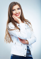 Casual style young woman posing on isolated studio background.