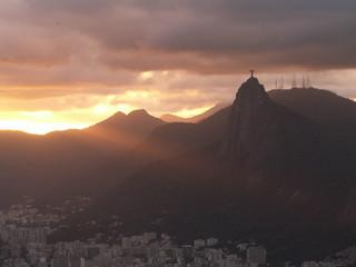 Christ Redeemer And Rio Sunset