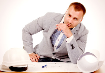 Male architect or engineer sitting at his desk