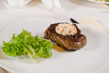 Steak with Herbed Butter and Garnish