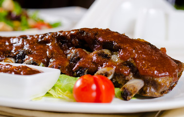 Rack of Saucy Barbecue Pork Ribs on Plate
