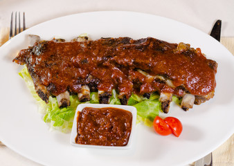 Plate of Saucy Barbecue Pork Ribs