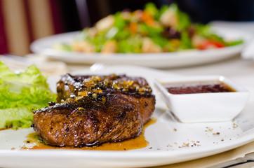 Gourmet Tender Juicy Grilled Meat on White Plate