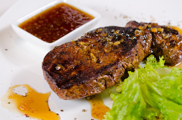 Tasty Grilled Steak Dish with Hot Chili Sauce