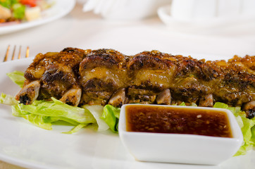 Close Up of Grilled Pork Ribs with Dipping Sauce