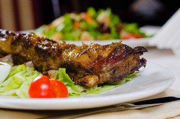 Rack of Grilled Pork Ribs on Plate in Restaurant
