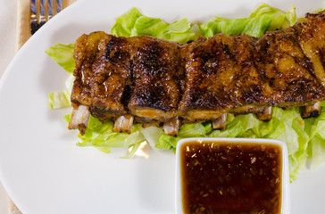 Grilled Pork Ribs with Dipping Sauce on Plate
