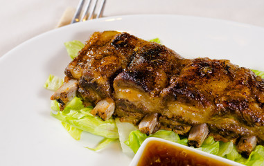 Close Up of Grilled Pork Ribs on Plate