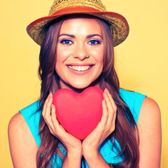 woman face portrait. model  holding red Heart.