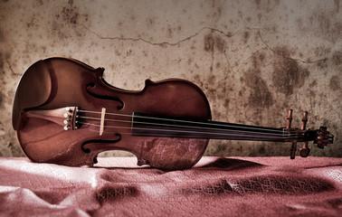 still life with vintage violin on silk